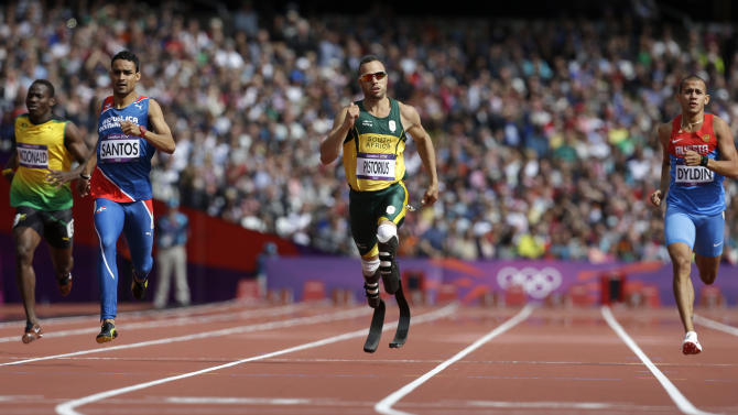 FILE - In this Saturday, Aug. 4, 2012 file photo, South Africa's Oscar Pistorius, center, leads Jamaica's Rusheen McDonald, left, Dominican Republic's Luguelin Santos, second left, and Russia's Maksim Dyldin, right, in a men's 400-meter heat during the athletics in the Olympic Stadium at the 2012 Summer Olympics, in London. (AP Photo/Anja Niedringhaus, File)