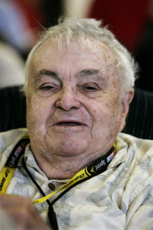 In this June 7, 2009, photo, journalist Chris Economaki works at a NASCAR auto race at Pocono Raceway in Long Pond, Pa. Economaki, a journalist regarded as the authoritative voice in motorsports for decades, died Friday, Sept. 28, 2012. He was 91. National Speed Sport News, where Economaki worked as an editor for more than 60 years, announced his death Friday. It did not release a cause of death. (AP Photo/Mel Evans)