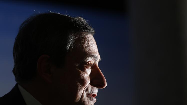Draghi, President of the European Central Bank (ECB) answers reporter's questions during his monthly news conference at the ECB headquarters in Frankfurt