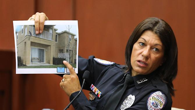 Sanford police officer Doris Singleton holds up a copy of a photo of the complex where the Trayvon Martin shooting took place, while testifying in Seminole circuit court, in Sanford, Fla., Monday, July 1, 2013. Zimmerman has been charged with second-degree murder for the 2012 shooting death of Trayvon Martin.(AP Photo/Orlando Sentinel, Joe Burbank, Pool)