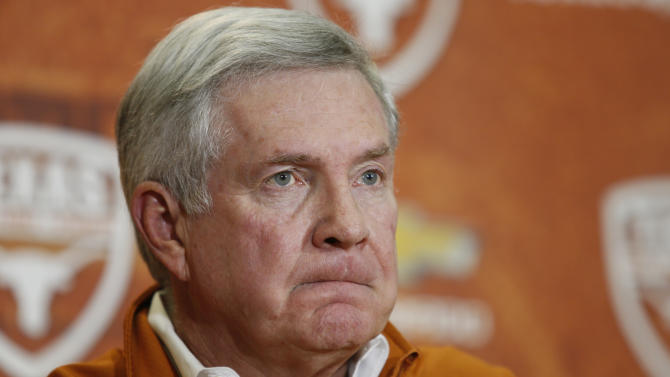 Mack Brown announces that he is stepping down as head football coach at Texas on Sunday, Dec. 15, 2013, in Austin, Texas. The Longhorns have had four straight seasons with at least four losses. Texas went 8-4 this year and Brown's final game will be the Dec. 30 Alamo Bowl against Oregon. (AP Photo/Jack Plunkett)