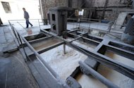 Waste is processed at a privately owned rare-earths factory on April 21, 2011 on the outskirts of Baotou city, in Inner Mongolia. China produces more than 90 percent of the world's supply of rare earths, but has clamped down on exports of them in a move Beijing says is aimed at protecting its environment and conserving supplies