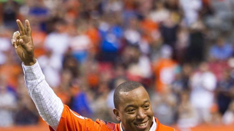 Former B.C Lions Geroy Simon gestures as his number is retired during a half-time celebration at the team's CFL football game against the Winnipeg Blue Bombers in Vancouver