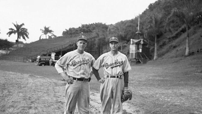 In this Feb. 23, 1942 file photo, Newell Kimball, left, and Curt Davis, of the Brooklyn Dodgers pitching staff, pose for a portrait during spring training in Havana, Cuba. The Wednesday, Dec. 17, 2014 announcement that the U.S. plans to restore diplomatic ties with the Caribbean nation could usher in a new era in U.S.-Cuba baseball relations, which were strained after the Castro revolution and the U.S.-led economic embargo