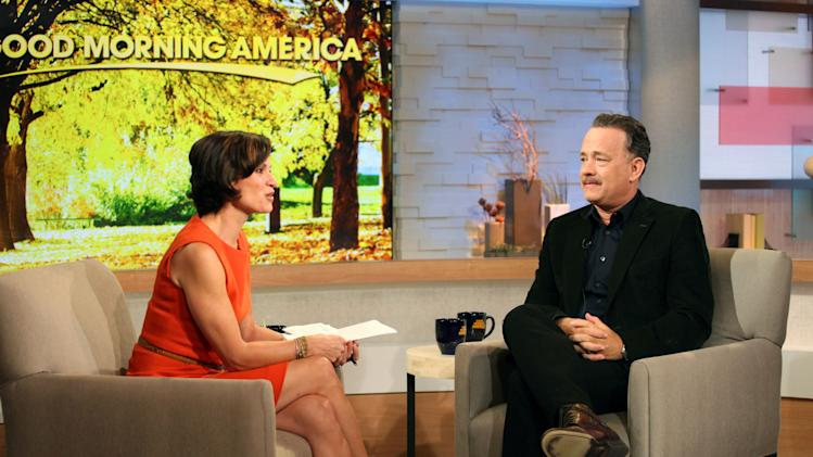 """This image released by ABC shows actor Tom Hanks during an interview segment with Elizabeth Vargas on """"Good Morning America,"""" Friday, Oct. 19, 2012 in New York. ABC and Tom Hanks are apologizing after the actor let slip a swear word during a live appearance on """"Good Morning America."""" Hanks telegraphed his """"f-bomb"""" during an interview Friday. Vargas had asked him to speak in his character's British accent in the movie """"Cloud Atlas."""" Hanks said that it was """"mostly swear words,"""" but Vargas told him to go ahead anyway. He began speaking in a mumble but the obscenity was clearly audible. ABC removed it for subsequent feeds of the show in the Midwest and West.  (AP Photo/ABC, Fred Lee)"""