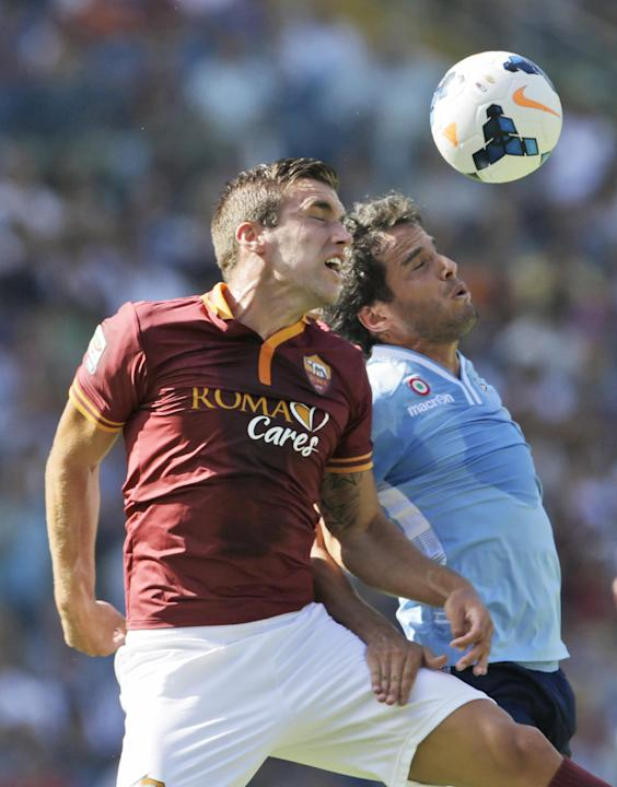 AS Roma midfielder Kevin Strootman of The Netherlands, left, and Lazio midfielder Alvaro Gonzalez of Uruguay jump for the ball during a Serie A soccer match between As Roma and Lazio, in Rome's Olympi
