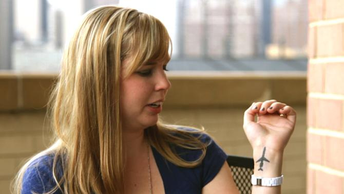 """Cecelia Crocker, the lone survivor of a 1987 plane crash near Detroit Metropolitan Airport that killed 156 people, shows an airplane tattoo on her left wrist in a September 2011 photo provided by Sole Survivor Film. Crocker, then Cichan, was was 4 years old when Northwest Airlines Flight 255 crashed in Romulus, Mich. Crocker, now 30, breaks her silence in the new documentary, """"Sole Survivor,"""" discussing how the crash of the Phoenix-bound jetliner has affected her. """"I got this tattoo as a reminder of where I've come from. I see it as — so many scars were put on my body against my will — and I decided to put this on my body for myself,"""" she says in the film. (AP Photo/Sole Survivor Film)"""