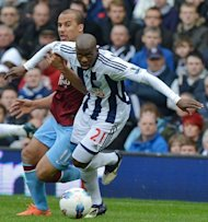 Aston Villa's Gabriel Agbonlahor (L) fights for the ball with West Bromwich Albion's Youssouf Mulumbu during their English Premier League match at The Hawthorns in West Bromwich, on April 28. West Brom host Arsenal next, on Sunday