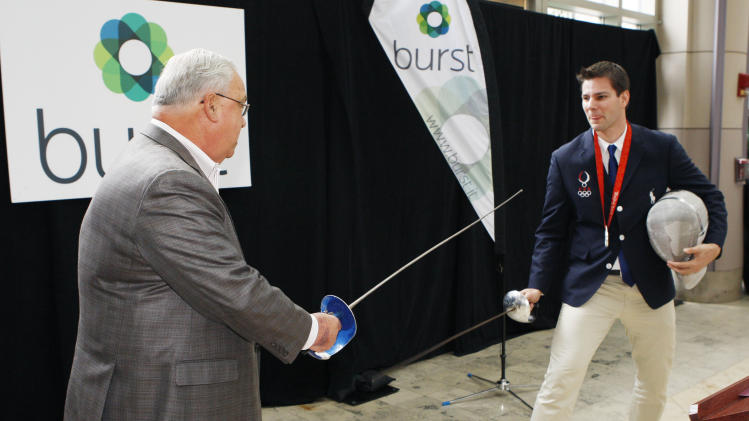 "COMMERCIAL IMAGE -  In this photograph taken by AP Images for Burst, U.S. Olympic fencer Tim Morehouse, right, duels Boston Mayor Thomas M. Menino during the kick-off of Morehouse's new ""Burst from Behind the Scenes in London"" program, hosted by Boston start-up Burst and Boston Properties, at the Shops at the Prudential Center, Thursday, July 5, 2012, in Boston. (Bizuayehu Tesfaye/AP Images for Burst)"