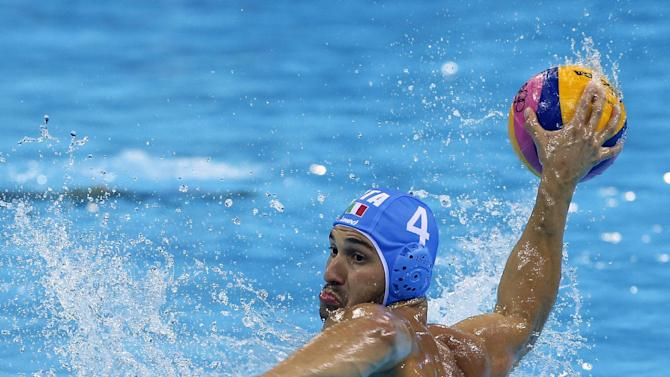 Pietro Figlioli of Italy shoots and scores a penalty goal against Spain during the men's water polo preliminary round match at the 2012 Summer Olympics, Monday, Aug. 6, 2012, in London. (AP Photo/Alastair Grant)