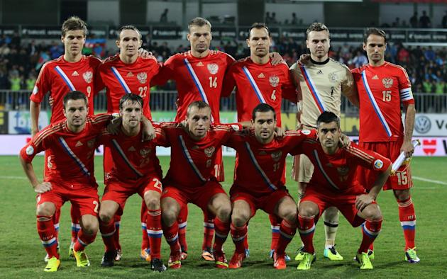 In this Oct. 15, 2013 file photo, Russia national team poses prior to the start the World Cup Group F qualifying soccer match between Russia and Azerbaijan in Baku, Azerbaijan. Foreground from left: V