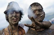 <p>Festival-goers pose for a photo at a 2011 music festival in Nyon. Two in three Swiss voters rejected a referendum Sunday aimed at tightening a smoking ban, to the relief of the hotel and restaurant sector that had complained of excess regulation.</p>