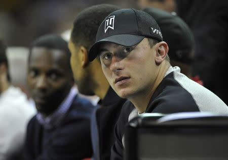 Cleveland Browns quarterback Johnny Manziel watches a Cleveland Cavaliers and Dallas Mavericks game in Cleveland, Ohio