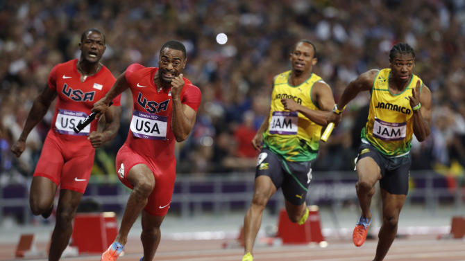FILE - In this Saturday, Aug. 11, 2012 file photo, from left, United States' Justin Gatlin hands  the baton to Tyson Gay, as Jamaica's Michael Frater hands the baton to Yohan Blake in the men's 4x100-meter relay final during the athletics in the Olympic Stadium at the 2012 Summer Olympics, London. Two officials with knowledge of the decision say the entire U.S. men's sprint relay team has been stripped of its silver medal from the 2012 London Olympics as a result of Tyson Gay's doping case. The officials spoke to The Associated Press on condition of anonymity because the decision has not yet been announced. They say the International Olympic Committee notified the U.S. Olympic Committee by letter on Wednesday, May 13, 2015 that the team has been disqualified and the medals withdrawn. The letter asks the USOC to collect the medals and return them to the IOC.  (AP Photo/Hassan Ammar, File)