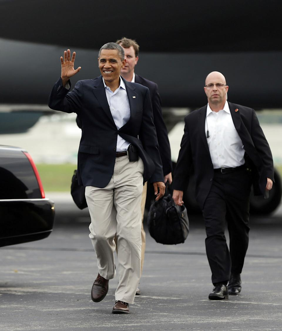 President Barack Obama waves to supporters as he walks across the tarmac to greet them upon his arrival at Toledo Express Airport, Sunday, Sept. 2, 2012, in Toledo, Ohio. (AP Photo/Pablo Martinez Monsivais)