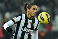 Juventus&#39; Martin Caceres, seen in action during their Italian Seria A match against Genoa, at the Juventus Stadium in Turin, on January 26, 2013. Caceres says the Italian champions must forget their Champions League midweek success over Celtic and concentrate on dealing with a potentially &#39;ruthless&#39; Roma on Saturday