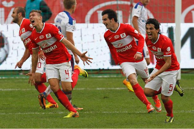 Spartak's Sergei Parshivlyuk, second left, celebrates a goal with his teammates during a Russian Premier League Championship soccer match between CSKA Moscow and Spartak Moscow at the Lokomotiv stadiu