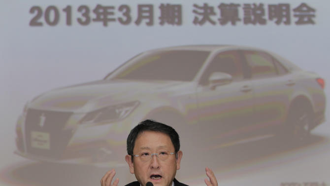 "Toyota Motor Corp. President Akio Toyoda speaks during a news conference at the automaker's headquarters in Tokyo, Wednesday, May 8, 2013. Toyota's January-March profit more than doubled to 313.9 billion yen (Canadian) $3.2 billion) as cost cuts and better sales worked with a weakening yen to add momentum to the automaker's comeback. The screen in the background reads: ""The announcement of the annual earnings result for March 2013."" (AP Photo/Itsuo Inouye)"