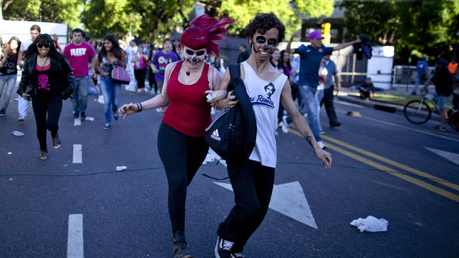 "Lady Gaga fans arrive at the venue where the U.S. pop star will perform a concert, in Buenos Aires, Argentina, Friday, Nov. 16, 2012. The Latin American leg of her, ""Born This Way Ball Tour,"" is coming to an end but not before stopping in Chile, Peru and Paraguay. (AP Photo/Natacha Pisarenko)"