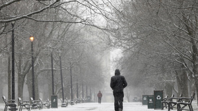 A pedestrian walks through the snow in Washington Park on Friday, Feb. 8, 2013, in Albany, N.Y. Parts of the New York region still cleaning up from Superstorm Sandy are bracing for a winter storm that's expected to blanket the Northeast with heavy snow Friday and Saturday. (AP Photo/Mike Groll)