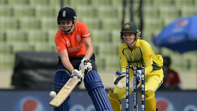 England cricketer Heather Knight (L) plays a shot during the ICC Women's World Twenty20 final between Australia and England at The Sher-e-Bangla National Cricket Stadium in Dhaka on April 6, 2014