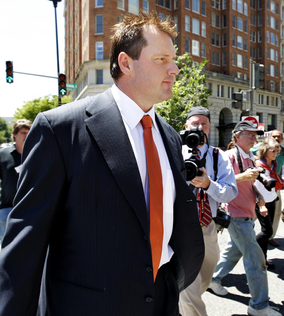 Former Major League baseball pitcher Roger Clemens leaves federal court in Washington, Thursday, July 14, 2011, after the judge declared a mistrial in his perjury trial after prosecutors showed jurors evidence that the judge had ruled out of bounds.  (AP Photo/Manuel Balce Ceneta)
