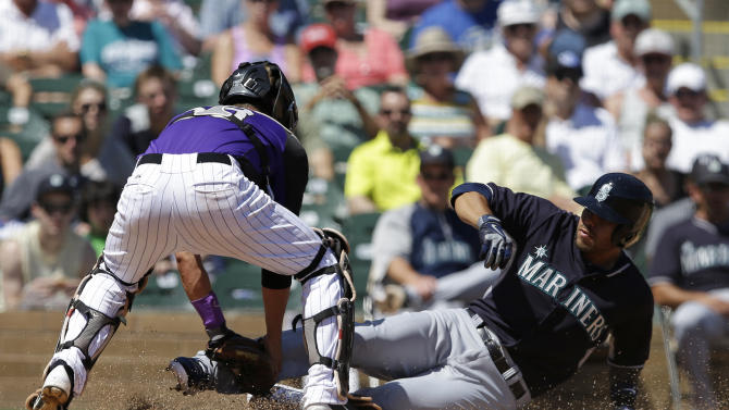 Young impresses Mariners in 2-1 loss to Rockies