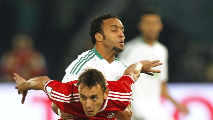 Issam Erraki of Morocco's Raja Casablanca fights for the ball with Rafinha of Germany's Bayern Munich during their 2013 FIFA Club World Cup final soccer match at Marrakech stadium