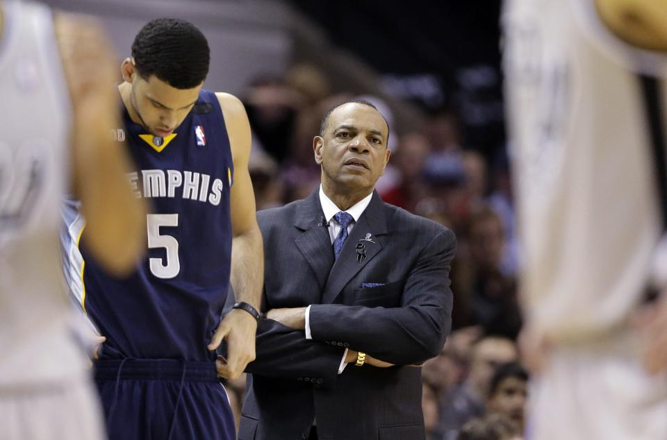 Memphis Grizzlies coach Lionel Hollins, center, watches play during the second half in Game 1 of a Western Conference Finals NBA basketball playoff series against the San Antonio Spurs, Sunday, May 19, 2013, in San Antonio. San Antonio won 105-83.  (AP Photo/Eric Gay)