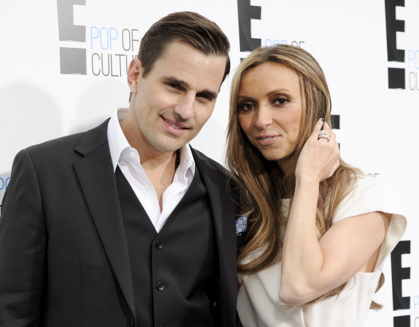 "FILE - This April 30, 2012 file photo shows Bill Rancic, left, and his wife Giuliana Rancic attending an E! Network upfront event at Gotham Hall in New York. The couple have welcomed son Edward Duke to their family. Edward was born in Denver via a gestational surrogate on Wednesday, Aug. 29. He weighed 7 pounds and 4 ounces. The couple was in the delivery room for the four-hour labor and birth. Giuliana Rancic is a red-carpet fixture and host of E! News, and Bill is an entrepreneur and motivational speaker, who was the first-season winner on TV's ""The Apprentice."" Together, they star in a Style Network reality show called ""Giuliana & Bill"" that dealt with their fertility issues. (AP Photo/Evan Agostini, file)"
