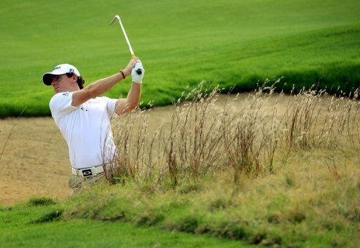 <p>World number one golfer Rory McIlroy of Northern Ireland plays a shot during the Pro-Am event for the BMW Shanghai Masters golf tournament at the Lake Malaren Golf Club in Shanghai on October 24, 2012. McIlroy's big-money switch of sponsors to Nike is set to be announced in Abu Dhabi on Monday, press reports have said.</p>