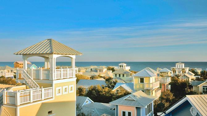 """This undated image provided by Visit South Walton shows the picturesque town of Seaside, located in the Florida Panhandle. Seaside is known for its pastel-colored homes and beautifully landscaped walkways and public areas. Developed in 1981 as a planned resort community, Seaside was the setting of the 1998 film, """"The Truman Show,"""" starring Jim Carrey. (AP Photo/Visit South Walton)"""