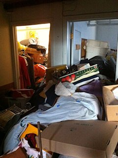 Boxes, clothes, and bins take over rooms and hallways