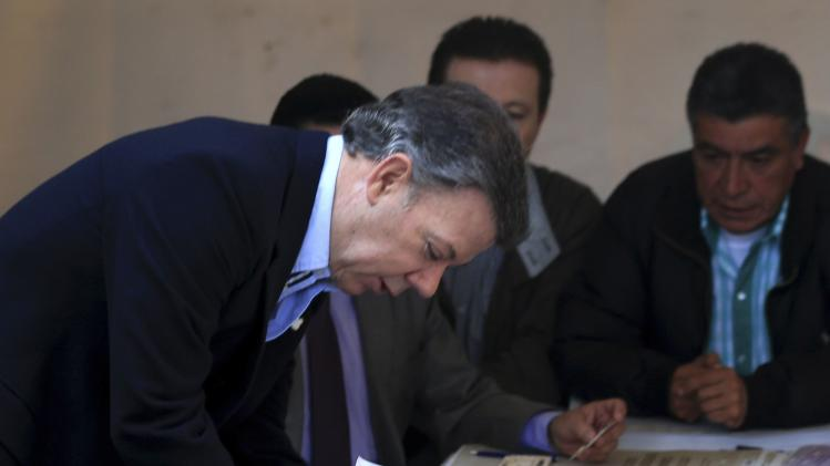 Colombia's President Santos casts his vote during congressional elections in Bogota