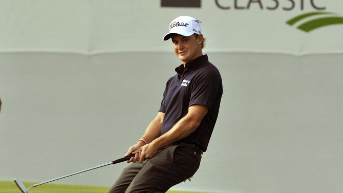 Bud Cauley reacts after missing a birdie putt on the 17th green during the second round of The McGladrey Classic PGA Tour golf tournament, Friday, Oct. 19, 2012, in St. Simons Island, Ga. (AP Photo/Stephen Morton)