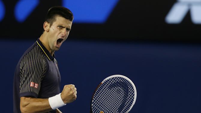 Serbia's Novak Djokovic reacts after winning the second set during the men's final against Britain's Andy Murray at the Australian Open tennis championship in Melbourne, Australia, Sunday, Jan. 27, 2013. (AP Photo/Dita Alangkara)