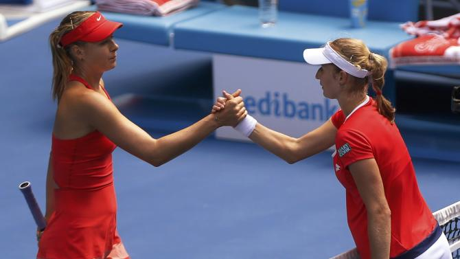 Sharapova of Russia shakes hands with compatriot Makarova of Russia after winning their women's singles semi-final match at the Australian Open 2015 tennis tournament in Melbourne