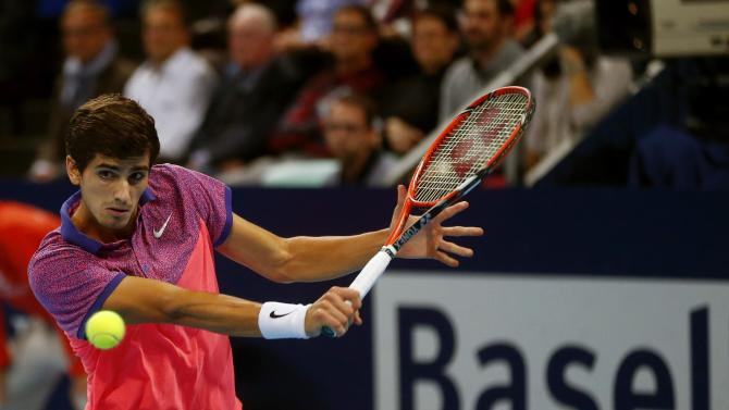 France's Herbert prepares to return the ball during his match against Nadal of Spain at the Swiss Indoors ATP tennis tournament in Basel