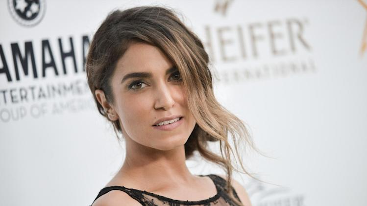 """Nikki Reed arrives at the 3rd Annual Beyond Hunger """"A Place At The Table"""" Gala on Friday, Aug. 22, 2014, in Beverly Hills, Calif. (Photo by Richard Shotwell/Invision/AP)"""