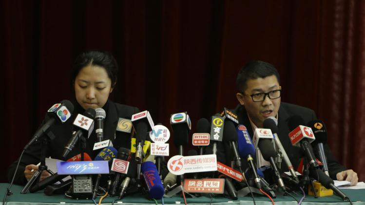 Malaysia Airlines representatives speak at a news conference about information on Malaysia Airlines flight MH370, in Beijing