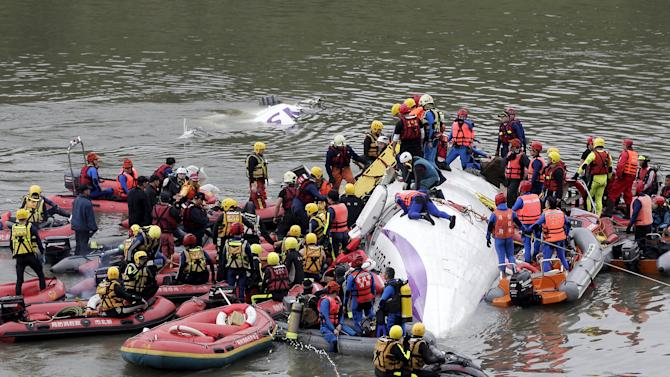 File photo of rescuers carrying out rescue operations after a TransAsia plane crashed into a river in New Taipei City