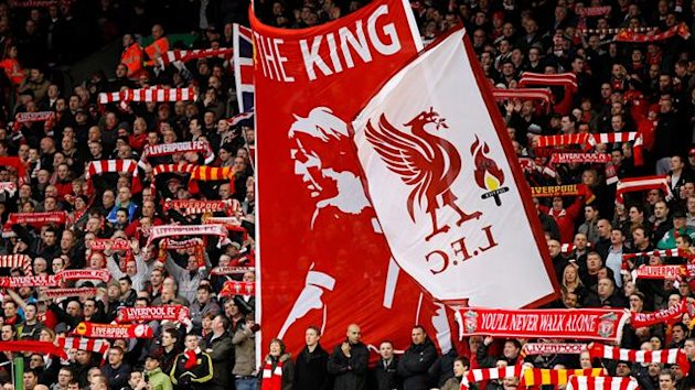 Liverpool&#39;s fans hold up scarves and banners