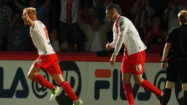 Stevenage's Jordan Burrow, left, celebrates scoring during the Capital One Cup win over Ipswich