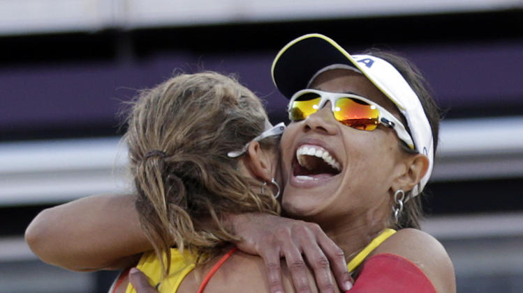 Brazil's Juliana Silva, right, hugs Larissa Franca following a win over  China in the women's Bronze Medal beach volleyball match at the 2012 Summer Olympics, Wednesday, Aug. 8, 2012, in London. (AP Photo/Dave Martin)