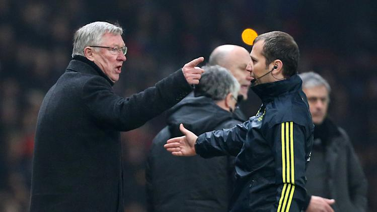 Manchester United's manager Sir Alex Ferguson remonstrates with the fourth official after his player Nani was shown a red card during the Champions League round of 16 soccer match against Real Madrid at Old Trafford Stadium, Manchester, England, Tuesday, March 5, 2013. (AP Photo/Jon Super)