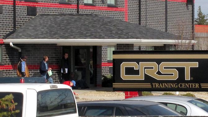A March 12, 2012, photo shows the training center for the trucking company CRST Van Expedited, Inc., in Cedar Rapids, Iowa. Dozens of female employees at CRST, one of the nation's largest trucking companies, say they experienced aggressive sexual harassment by male drivers during training rides, but their legal claims have been dismissed because of missteps by Equal Employment Opportunity Commission investigators. (AP Photo/Ryan J. Foley)