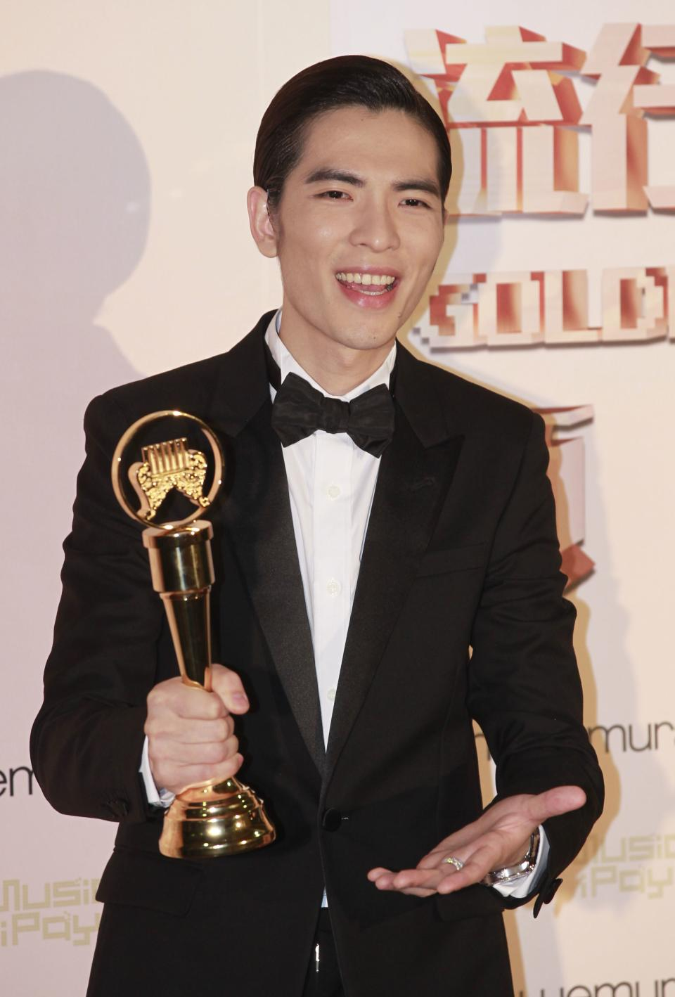 Taiwanese singer Jam Hsiao holds his award for Best Male Vocal Performer at the 24th Golden Melody Awards in Taipei, Taiwan, Saturday, July 6, 2013. The Golden Melody Awards is one of the Chinese-language pop music world's biggest annual events.(AP Photo/Wally Santana)
