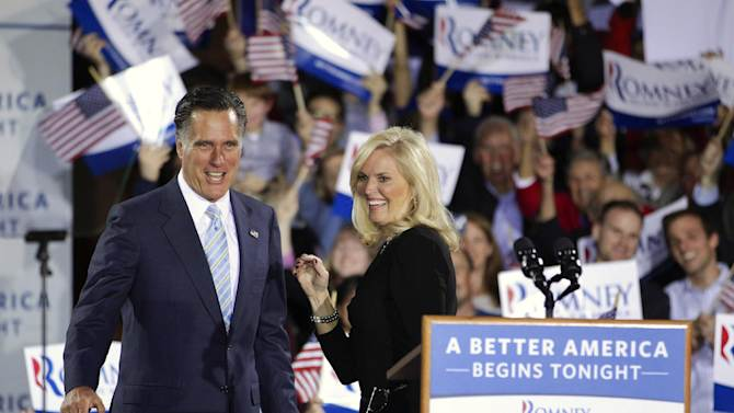 Republican presidential candidate, former Massachusetts Gov. Mitt Romney and wife, Ann, take the stage at an election night rally in Manchester, N.H., Tuesday, April 24, 2012. (AP Photo/Jae C. Hong)