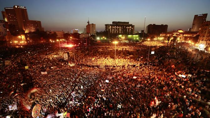 Egyptians gather at Tahrir Square in Cairo to call for a new revolution in Egypt, Saturday, June 2, 2012. Hosni Mubarak was sentenced to life in prison Saturday for failing to stop the killing of protesters during the uprising that forced him from power last year. The ousted president and his sons were acquitted, however, of corruption charges in a mixed verdict that swiftly provoked a new wave of anger on Egypt's streets. (AP Photo/Fredrik Persson)
