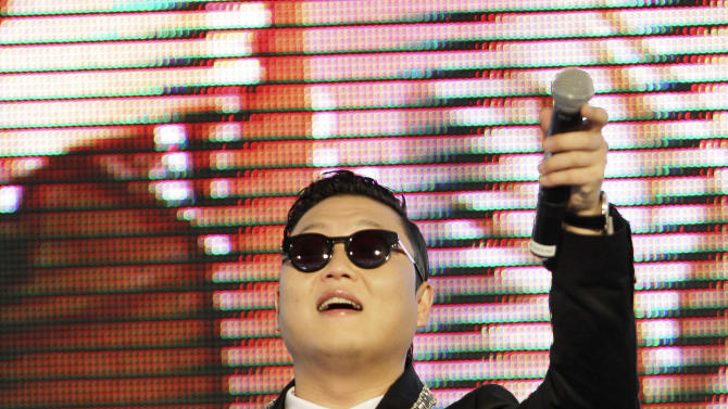 "South Korean rapper PSY, who sings the popular ""Gangnam Style,"" greets Thai fans during a press conference in Bangkok, Thailand, Wednesday, Nov. 28, 2012. PSY will perform in Thailand on Wednesday night -  his first show in Asia outside of South Korea.  (AP Photo/Sakchai Lalit)"